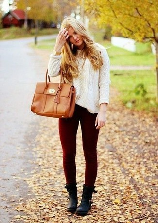 How to wear: white cable sweater, burgundy skinny jeans, black leather ankle boots, tan leather tote bag