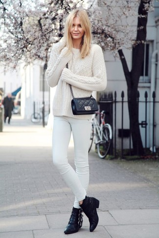 Opt for a Valentino Studded Cable Knit Jumper and white skinny jeans and you'll look like a total babe. Black leather ankle boots will instantly elevate even the laziest of looks. So if you're hunting for an outfit that's seriously stylish but also feels entirely spring_friendly, this one fits the task well.
