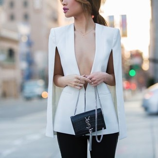 White Cape Blazer Outfits: This casual combo of a white cape blazer and black skinny pants takes on different nuances depending on the way it's styled.