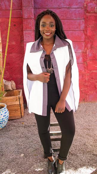 How to wear: white cape coat, black lace jumpsuit, black leather ankle boots, gold pendant