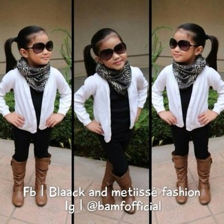 How to Wear Black Leggings For Girls: You'll have no problem tempting your darling into wearing this combo of a white cardigan and black leggings. As for footwear your little girl will love brown boots for this style.