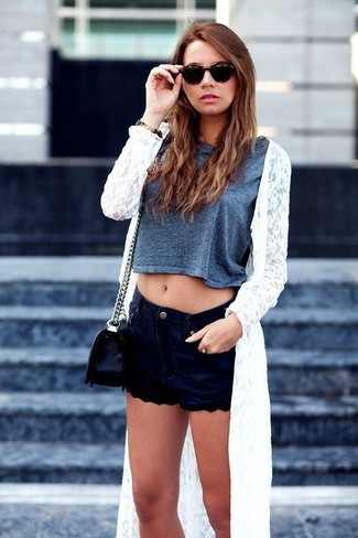 Marry a silver cropped top with navy blue denim shorts to achieve a chic look.