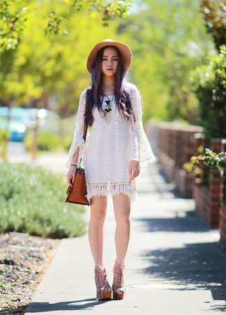 Opt for a white crochet casual dress to be both cool and relaxed. Choose a pair of pale pink leather lace-up ankle boots to kick things up to the next level. Ideal for hot weather, this look will gain quite a few likes on the 'gram too.