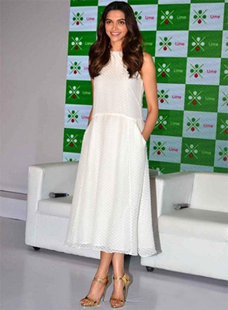 Deepika Padukone wearing White Chiffon Midi Dress, Gold Leather Heeled Sandals
