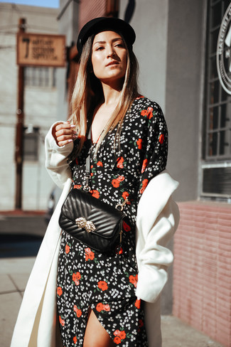How to Wear a Black Floral Maxi Dress: Pairing a black floral maxi dress with a white coat is an on-point pick for a cool and relaxed look.