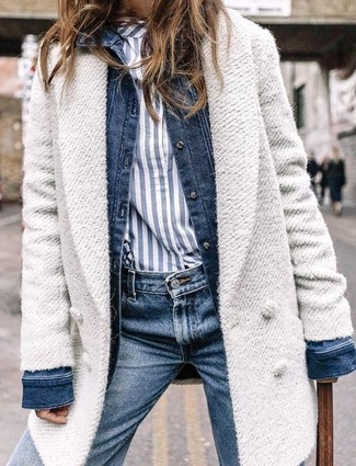 How to wear: white coat, navy denim jacket, white and navy vertical striped dress shirt, navy jeans