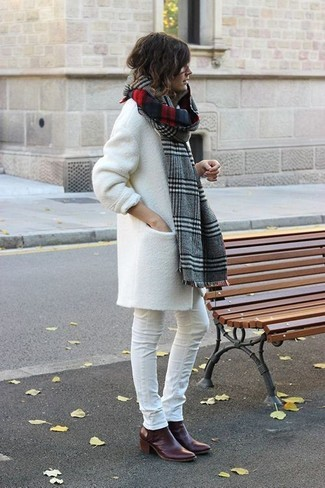 Pairing a white coat with a grey plaid scarf is an on-point option for a day in the office. Balance this getup with burgundy leather ankle boots. This one will play especially well when spring arrives.