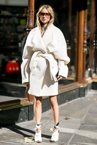 How to wear: white coat, white turtleneck, white cutout leather ankle boots, brown sunglasses