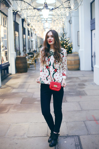 How to wear: white christmas crew-neck sweater, black skinny jeans, black leather ankle boots, red leather crossbody bag