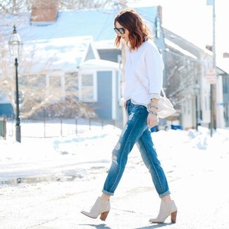 How to wear: white crew-neck sweater, blue ripped boyfriend jeans, beige leather ankle boots, beige leather crossbody bag