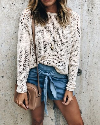 How to wear: white crochet crew-neck sweater, blue denim shorts, brown leather crossbody bag, gold pendant
