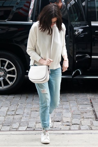 How to wear: white crew-neck sweater, light blue ripped boyfriend jeans, white low top sneakers, white leather crossbody bag