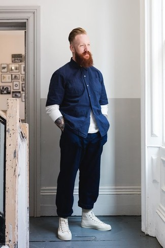 How to wear: white crew-neck sweater, navy chambray short sleeve shirt, navy chinos, white leather high top sneakers