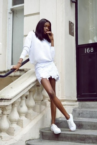 White Lace Mini Skirt Outfits: If you gravitate towards relaxed style, why not wear this pairing of a white crew-neck sweater and a white lace mini skirt? If you're clueless about how to round off, introduce a pair of white low top sneakers to the equation.
