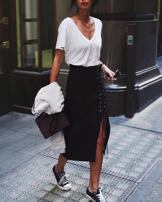 How to Wear Black and White Low Top Sneakers For Women: Team a white crew-neck sweater with a black slit midi skirt to create a totaly chic look. For something more on the daring side to complement this outfit, complement your ensemble with a pair of black and white low top sneakers.
