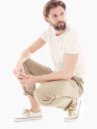 This combo of a white crew-neck t-shirt and nude chinos will enable you to keep your off-duty style clean and simple. A pair of nude plimsolls looks proper here. This getup is truly a lesson in how to master the summer fashion.