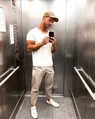 How to wear: white crew-neck t-shirt, beige chinos, white low top sneakers, tan baseball cap
