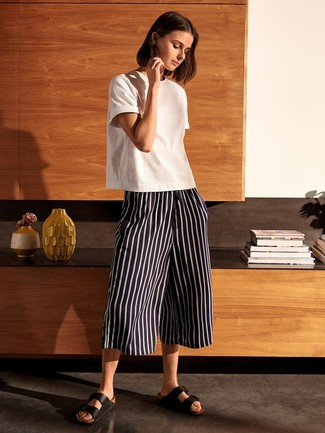How to wear: white crew-neck t-shirt, black and white vertical striped culottes, black leather flat sandals