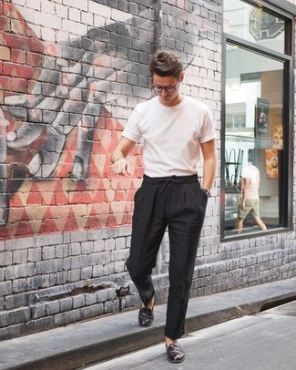 How to Wear Burgundy Leather Loafers For Men: This pairing of a white crew-neck t-shirt and black linen chinos is solid proof that a safe casual look doesn't have to be boring. Complement your outfit with a pair of burgundy leather loafers for some extra elegance.