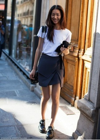 How to wear: white crew-neck t-shirt, black mini skirt, black leather loafers, black leather crossbody bag