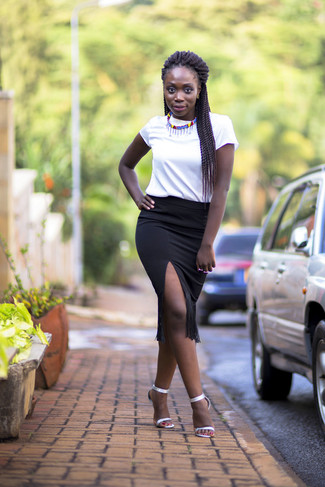 Step up your off-duty look in a white crew-neck t-shirt and a black fringe pencil skirt. Silver leather heeled sandals will add elegance to an otherwise simple look. So if you're on a mission for an insta-worthy outfit on a warm weather day, this just might be it.