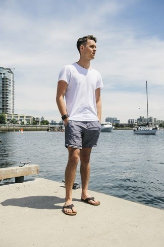 How to Wear a Black Rubber Watch For Men: Infuse personality into your day-to-day routine with a white crew-neck t-shirt and a black rubber watch. Puzzled as to how to round off? Grab a pair of black leather flip flops to jazz things up.