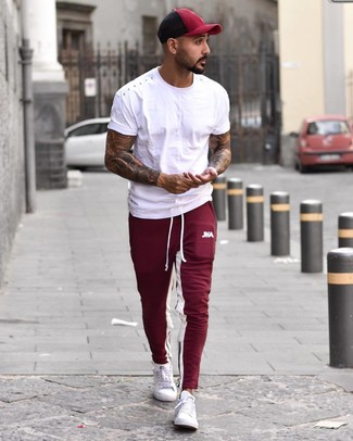 How to wear: white crew-neck t-shirt, burgundy sweatpants, white low top sneakers, burgundy baseball cap