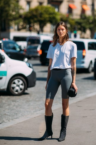 How to wear: white crew-neck t-shirt, charcoal bike shorts, black suede mid-calf boots, gold necklace