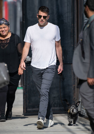 How to wear: white crew-neck t-shirt, charcoal chinos, white leather low top sneakers, dark brown sunglasses
