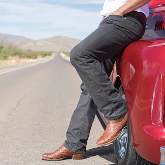 How to Wear Charcoal Jeans For Men: A white crew-neck t-shirt and charcoal jeans are a combination that every modern gent should have in his casual sartorial collection. Tone down the formality of your look by sporting brown leather cowboy boots.
