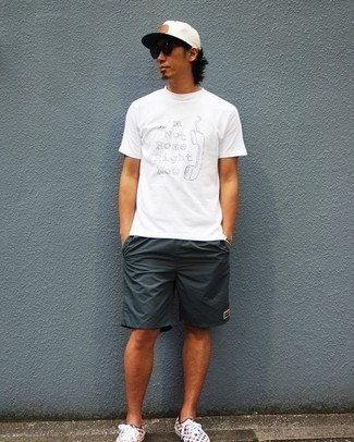 How to Wear a White Print Crew-neck T-shirt For Men: A white print crew-neck t-shirt and charcoal shorts are worth being on your list of menswear essentials. A pair of multi colored check low top sneakers rounds off this outfit very nicely.