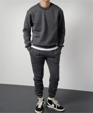 How to Wear a Track Suit For Men: A track suit and a white crew-neck t-shirt are an edgy combination that every modern guy should have in his wardrobe. Black and white suede high top sneakers are a good idea to round off this look.