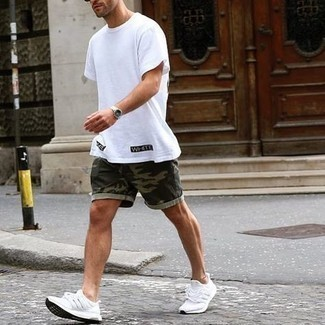 White Print Crew-neck T-shirt Outfits For Men: Why not rock a white print crew-neck t-shirt with dark green camouflage shorts? As well as very practical, these two pieces look good when married together. For something more on the casual and cool side to complete this getup, add a pair of white athletic shoes to the mix.