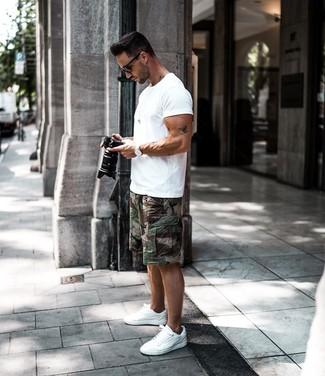 How to wear: white crew-neck t-shirt, dark green camouflage shorts, white low top sneakers, black sunglasses