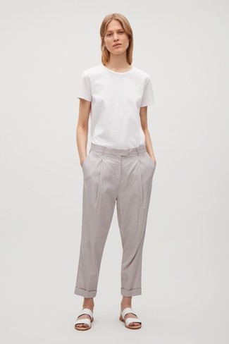 How to wear: white crew-neck t-shirt, grey chinos, white leather flat sandals
