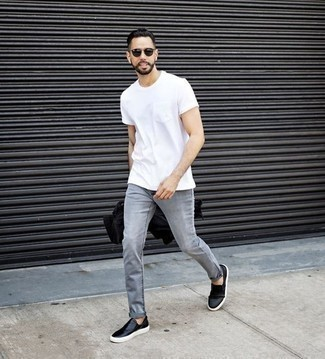 Men's Looks & Outfits: What To Wear Casually: This ensemble with a white crew-neck t-shirt and grey jeans isn't so hard to pull together and is easy to adapt throughout the day. Feeling adventerous today? Spruce up your getup by rounding off with a pair of black leather slip-on sneakers.