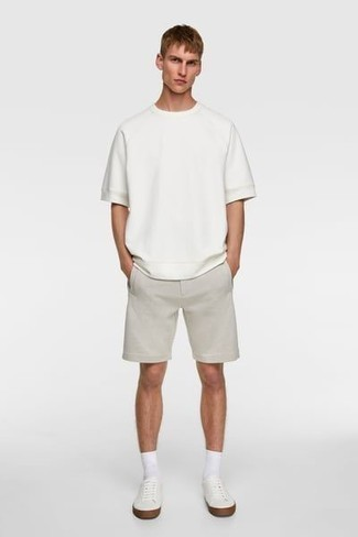 How to Wear Grey Shorts For Men: A white crew-neck t-shirt and grey shorts will convey this relaxed and dapper vibe. White canvas low top sneakers are a stylish addition for your ensemble.