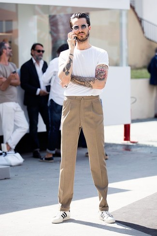 A smart casual combination of a white crew-neck tee and camel trousers can  maintain