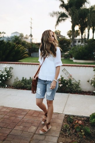 How to wear: white lace crew-neck t-shirt, light blue ripped denim bermuda shorts, brown leather espadrilles, brown fringe leather crossbody bag