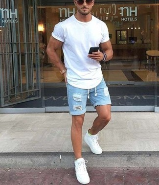 How to wear: white crew-neck t-shirt, light blue ripped denim shorts, white low top sneakers