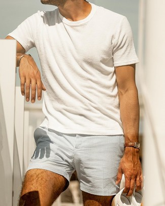 How to wear: white crew-neck t-shirt, light blue vertical striped seersucker shorts, white leather low top sneakers, brown leather watch