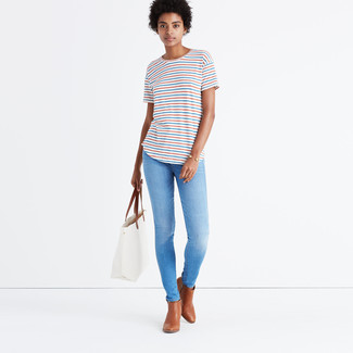 How to wear: white horizontal striped crew-neck t-shirt, light blue skinny jeans, brown leather ankle boots, white leather tote bag