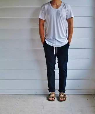 500+ Relaxed Outfits For Men: For a casually dapper getup, opt for a white crew-neck t-shirt and navy chinos — these two pieces work pretty good together. If you want to break out of the mold a little, complement this ensemble with a pair of tan suede sandals.