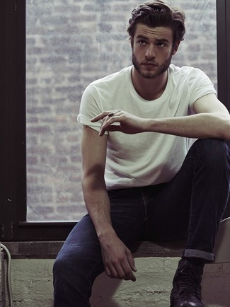 A white crew-neck t-shirt and navy jeans is a good combination to carry you throughout the day. Rock a pair of black leather boots for a masculine aesthetic.