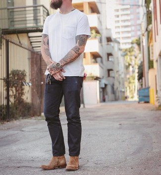 How to wear: white crew-neck t-shirt, navy jeans, tan suede cowboy boots