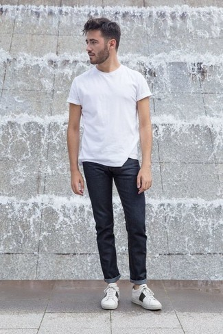 Fashion for 20 Year Old Men: What To Wear: Pair a white crew-neck t-shirt with navy jeans for both stylish and easy-to-create look. Complete your look with white and black canvas low top sneakers and the whole ensemble will come together. Those wondering how to wear modern casual looks as you go through your 20s, this pairing should answer your question.