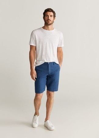 White Leather Low Top Sneakers Summer Outfits For Men: A white crew-neck t-shirt and navy shorts are amazing menswear must-haves that will integrate nicely within your casual styling rotation. If you're clueless about how to finish off, a pair of white leather low top sneakers is a wonderful option. So if it's a super hot summer afternoon and you want to look sharp without putting in too much work, this outfit will do the job in next to no time.
