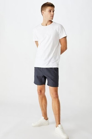 White Leather Low Top Sneakers Summer Outfits For Men: For a relaxed casual getup, try pairing a white crew-neck t-shirt with navy shorts — these items play nicely together. Complete your look with white leather low top sneakers and off you go looking dashing. We love that this combination is great when sunny days set in.