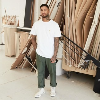 How to wear: white crew-neck t-shirt, olive chinos, white canvas high top sneakers