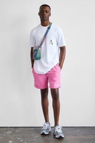 How to Wear a White Print Crew-neck T-shirt For Men: A white print crew-neck t-shirt and pink shorts are a great ensemble worth incorporating into your current rotation. If you wish to instantly dial down this getup with one item, complement this ensemble with a pair of grey athletic shoes.